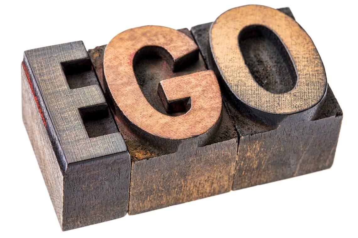 ego spelt with wooden letter blocks